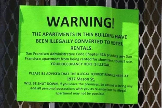 Warning Sign Activists Stick On Illegally Converted Airbnbs - Warning Sign Activists Stick On Illegally Converted Airbnbs
